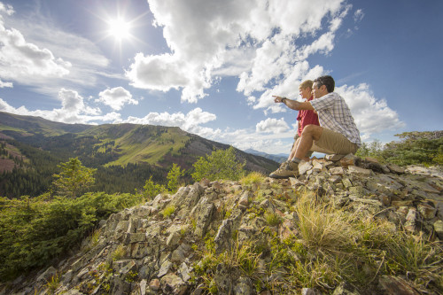 Two people at a scenic overlook while hiking near Aspen.