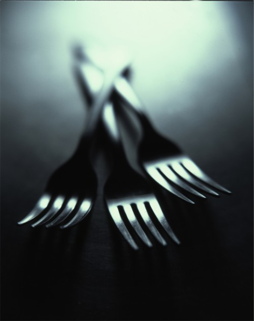 Three forks on display to represent dining at the Limelight Hotel Aspen.