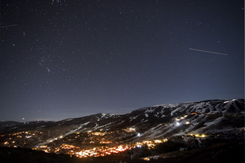A starlit sky featuring a shooting star over a relaxing night in Aspen
