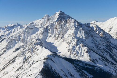 A mountain in Aspen near the Limelight Hotel Aspen, which is used for skiing and ice climbing in the winter.