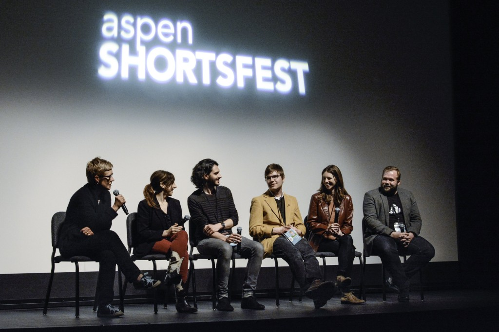 Laura Thielen on stage with filmmakers for a post-screening Q&A