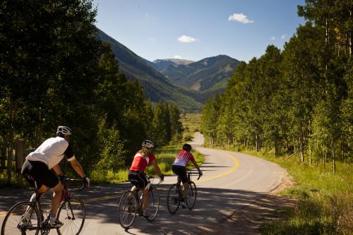 A trio of cyclists training for bike racing season near Aspen.