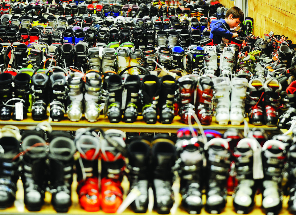 Bridger Ski Foundation Ski Swap volunteer Ansel Brayton finds a spot to squeeze a pair of ski boots onto a table in preparation for today's BSF Ski Swap at the Gallatin County Fairgrounds. Doors open at Saturday at 9 a.m. for BSF members and 10 a.m. for the general public.