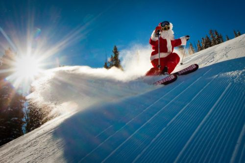 Celebrating the holidays in the mountains - santa skiing